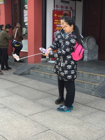 Selfie's and slefie sticks are MANDATORY in China!